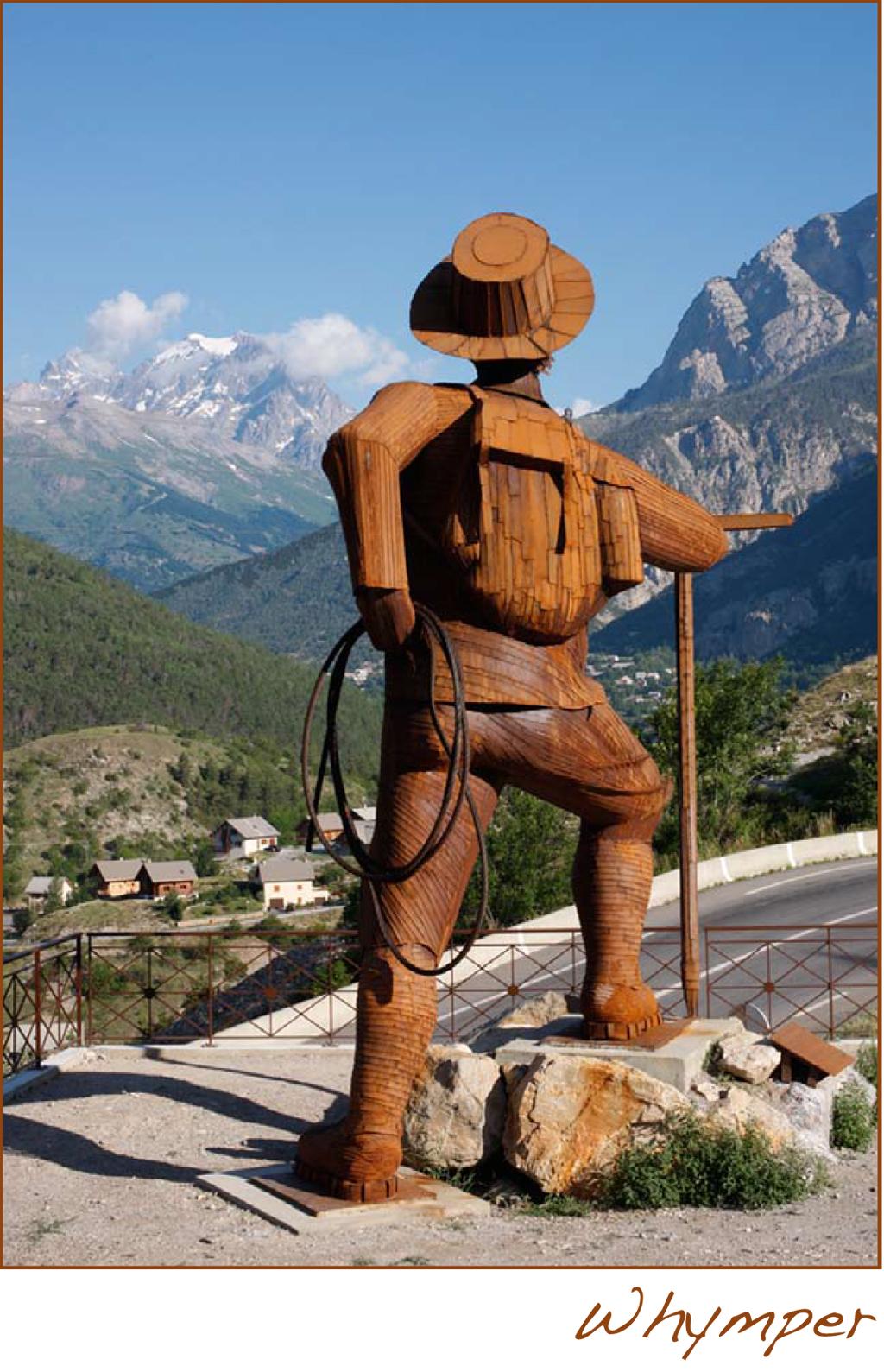 photo de la sculpture d'edward whymper regardant le massif des écrins. sculpture acier corten